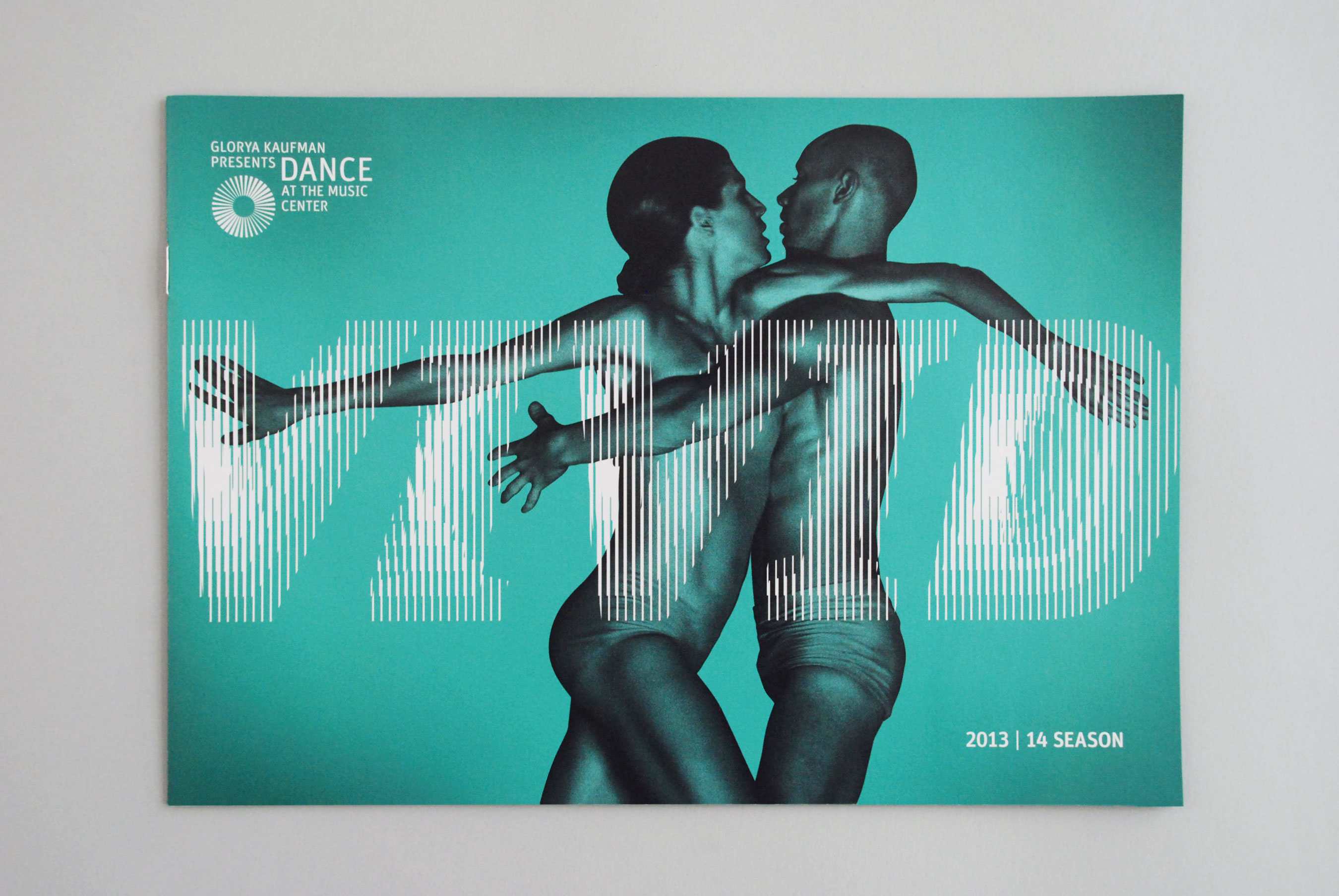 "Two dancers intertwined with the word ""VIVID"""